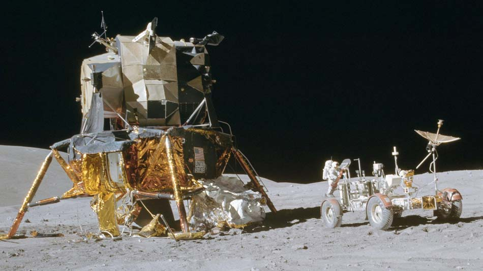 """An excellent view of the Lunar Module (LM) """"Orion"""" and Lunar Roving Vehicle (LRV), as photographed by astronaut Charles M. Duke Jr., lunar module pilot, during the first Apollo 16 extravehicular activity (EVA) at the Descartes landing site. Photo Credit: NASA"""