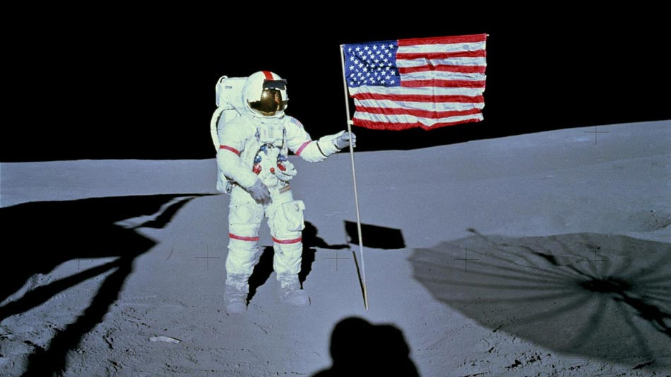 Astronaut Alan B. Shepard Jr., commander of the Apollo 14 lunar landing mission, stands by the deployed United States flag on the lunar surface during the early moments of the first extravehicular activity (EVA) of the mission. Photo Credit: NASA