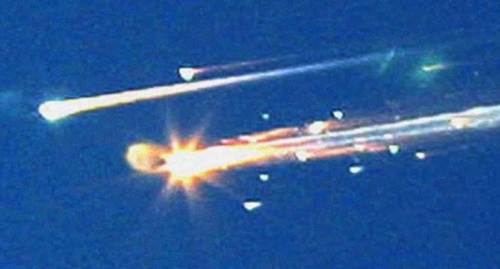 Debris from the space shuttle Columbia streaks across the sky over Tyler Texas on Feb 1 2003.