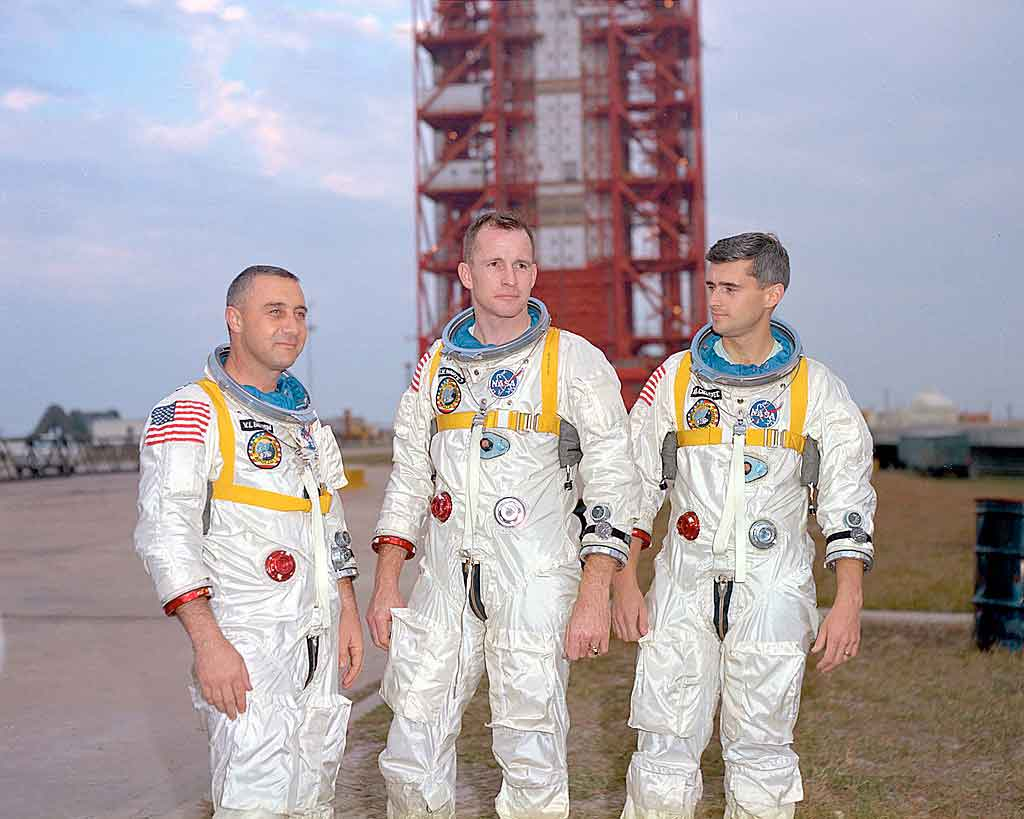 Grissom,-White,-and-Chaffee-in-front-of-the-launch-pad-containing-their-AS-204-space-vehicle