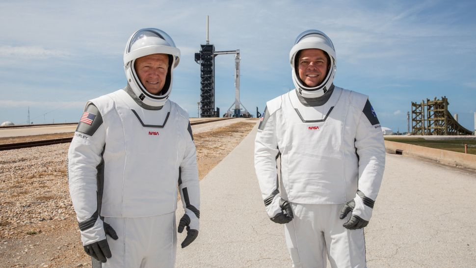 Astronauts Doug Hurley (left) and Bob Behnken in their SpaceX spacesuits at Launch Pad 39A with their Falcon 9 rocket and Crew Dragon spacecraft in the background before launch. The SpaceX pressure suits are designed to keep astronauts safe in the spacecraft and not for spacewalks. (Image credit: Kim Shiflett/NASA)