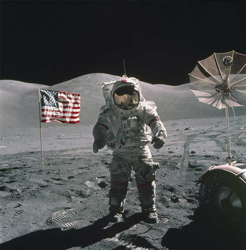 This is an Apollo 17 Astronaut standing upon the lunar surface with the United States flag in the background. The seventh and last manned lunar landing and return to Earth mission, the Apollo 17. Photo Credit: NASA