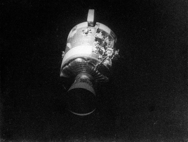 This view of the severely damaged Apollo 13 Service Module (SM) was photographed from the Lunar Module/Command Module (LM/CM) following SM jettisoning. Photo Credit: NASA