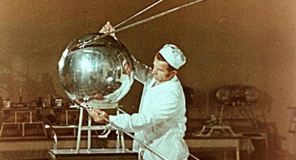 An engineer inspecting Sputnik 1