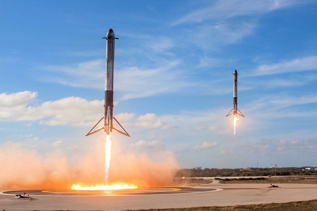 Falcon Heavy reusable side boosters land in unison at Cape Canaveral Landing Zones 1 and 2 following test flight on 6 February 2018.