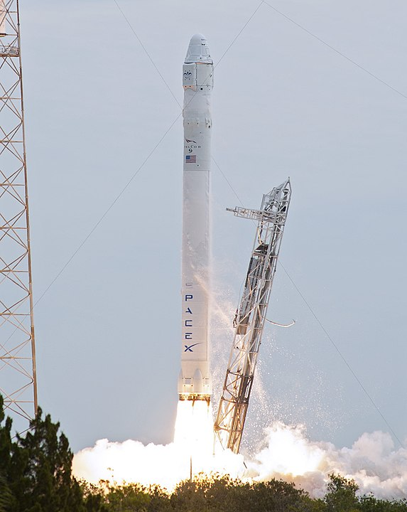 A Falcon 9 v1.0 being launched with a Dragon spacecraft to deliver cargo to the ISS in 2012.