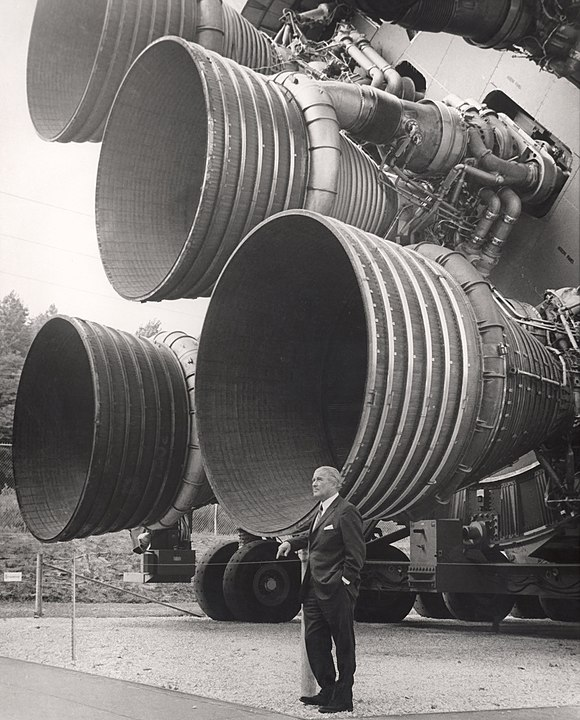 Von Braun with the F-1 engines of the Saturn V first stage at the U.S. Space and Rocket Center