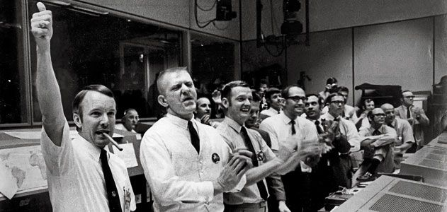 """Gene Kranz (in vest, as Apollo 13 safely splashed down) had faith that """"as a group, we were smart enough ... to get out of any problem. (Associated Press)"""