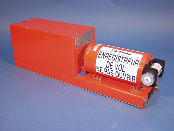 """An example of a flight data recorder; the underwater locator beacon is the small cylinder on the far right. (Translation of warning message in French: """"FLIGHT RECORDER DO NOT OPEN"""".) The warning appears in English on the other side."""