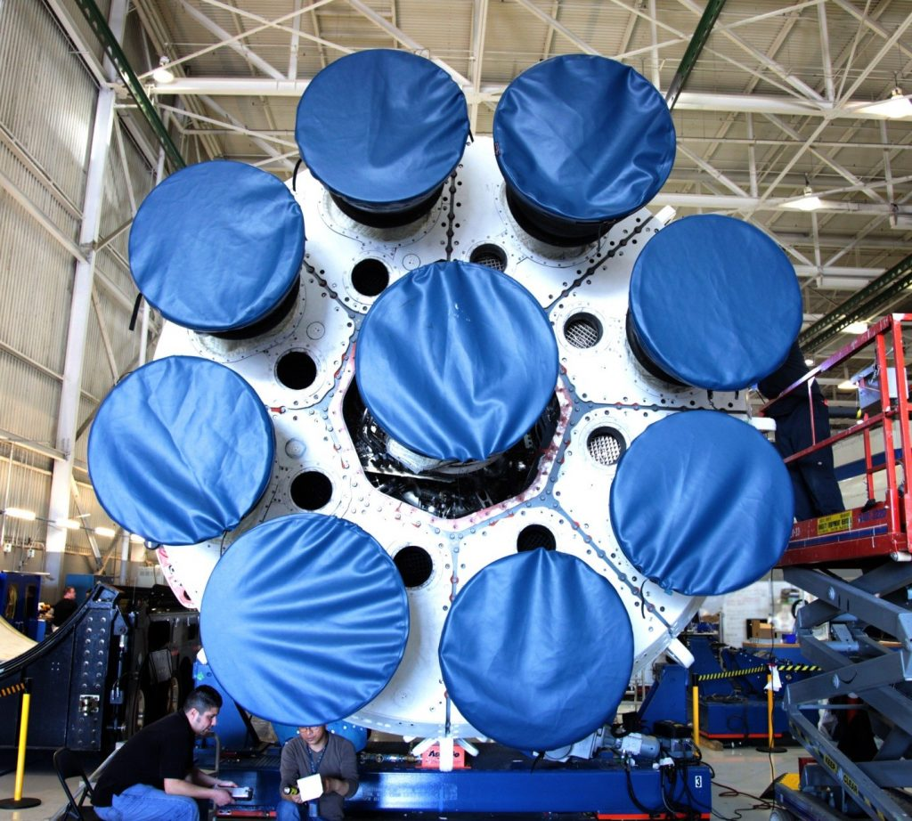 Engines are placed at offset. The smaller black holes is for the gas generator exhaust.