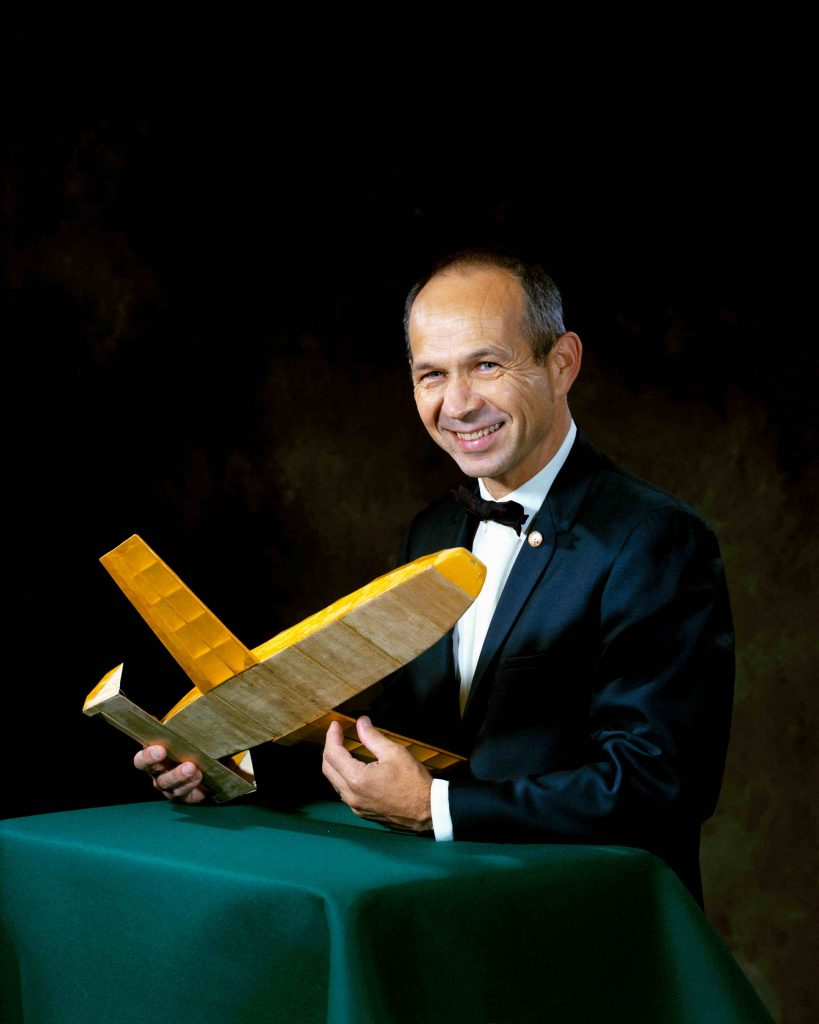 Maxime A. Faget holding a model of an early space shuttle vehicle. Credit: NASA