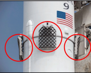Grid fins located near the top of first stage of Falcon 9 rocket