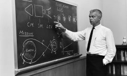 John C. Houbolt at blackboard, showing his space rendezvous concept for lunar landings. Although Houbolt did not invent the idea of LOR, he was the person most responsible for pushing it at NASA.