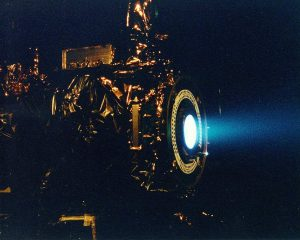 NASA's 2.3 kW NSTAR ion thruster for the Deep Space 1 spacecraft during a hot fire test at the Jet Propulsion Laboratory