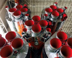 The first and second-stage engines of a Soyuz, showing the four RD-107 modules with twin vernier nozzles each, and the central RD-108 with four steerable vernier thrusters.